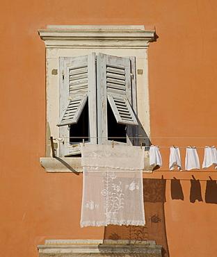 Laundry hanging from a shuttered window in Rovinj, Istria, Croatia, Europe