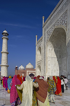 Women in brightly coloured saris at the Taj Mahal, UNESCO World Heritage Site, Agra, Uttar Pradesh, India, Asia