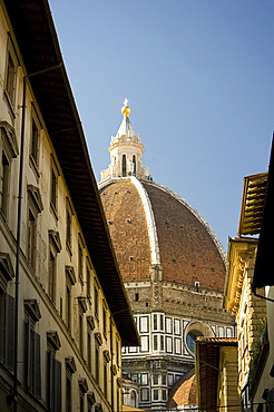A view of the Duomo through old buildings in Florence, UNESCO World Heritage Site, Tuscany, Italy, Europe