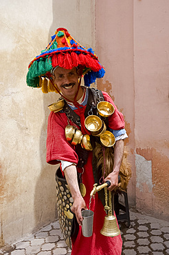 A water seller dressed in traditional colourful Berber dress in Marrakech, Morocco, North Africa, Africa