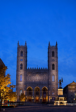 The Notre Dame Cathedral at dusk in the Place d'Arms, Montreal, Quebec Province, Canada, North America