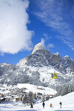 A view toward the town of Corvara and gondola at the Alta Badia ski resort with Sassongher Mountain behind, Dolomites, South Tyrol, Italy, Europe