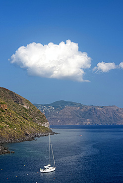 Rocky cliffs rising from the sea near Pollara on the island of Salina, The Aeolian Islands, UNESCO World Heritage Site, off Sicily, Messina Province, Italy, Mediterranean, Europe