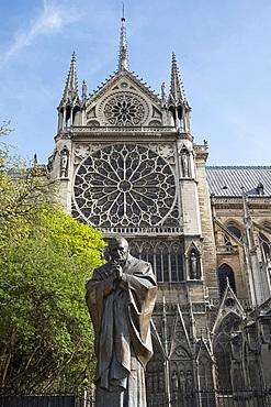 A statue of St. John Paul next to Notre-Dame Cathedral on the Ile de la Cite. Paris, France, Europe