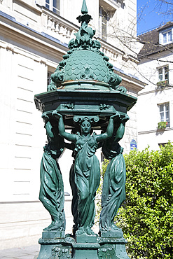 A green Wallace Fountain in the Place St.-Michel, Paris, France, Europe