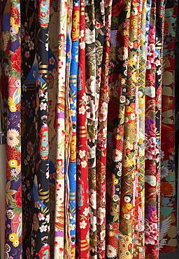 Colourful Japanese fabrics for sale at the Hida Takayama Miyagawa morning market in Takayama, Japan, Asia