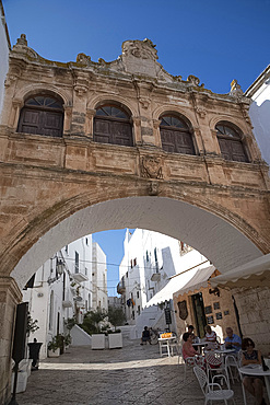 A Baroque style arch in the Centro Storico of the medieval city of Ostuni, Puglia, Italy, Europe