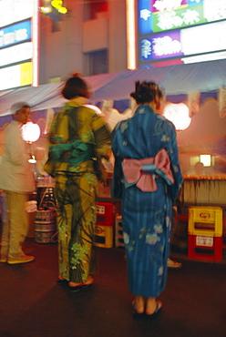 Japanese kimonos (defocussed), summer festival, Tokyo, Japan, Asia