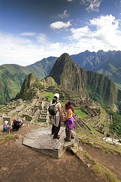 Tourists looking out over the ruins of the Inca site, Machu Picchu, UNESCO World Heritage Site, Urubamba Province, Peru, South America