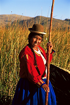 Uros Indian woman in traditional reed boat, Islas Flotantes, Lake Titicaca, Peru, South America