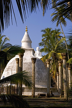 Great seated Buddha statue and dagoba (stupa) at Mihintale, where Buddhism first arrived in Sri Lanka, Mihintale, Sri Lanka, Asia