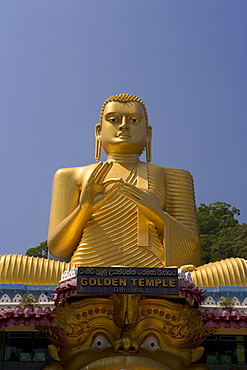 Giant gold seated Buddha statue at entrance to the Cave Temples, Golden Temple, Cave Temples, UNESCO World Heritage Site, Dambulla, Sri Lanka, Asia
