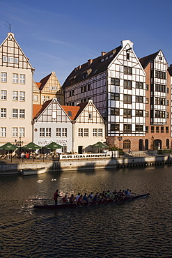 Restored warehouses along the Stara Motlawa River (Mottla River), Gdansk, Pomerania, Poland, Europe