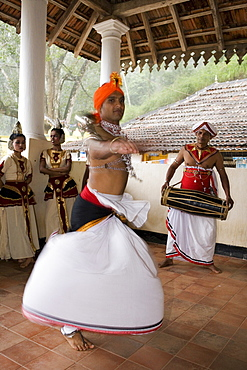 Kandyan Dance, considered the National Dance of Sri Lanka, the dancers are accompanied by drummers on the geta bera, Kandy, Hill Country, Sri Lanka, Asia