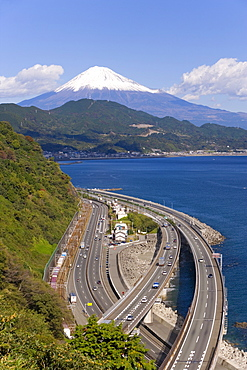 Elevated view over Expressway running along the Pacific coast, and Mount Fuji capped in snow beyond, Fuji-Hakone-Izu National Park, Chubu, Central Honshu, Japan, Asia