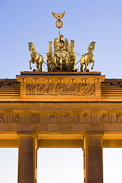 Quadriga on Brandenburger Tor (Brandenburg Gate) illuminated at night in Pariser Platz, Berlin, Germany, Europe