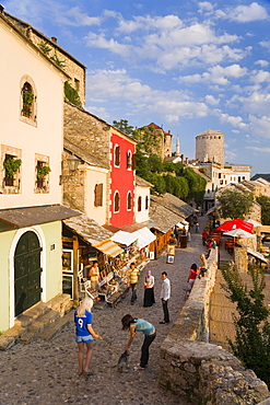 Cobbled street lined with colourful houses known as Kujundziluk, one of the oldest streets in Mostar leading to the Old Bridge, Old Town, UNESCO World Heritage Site, Mostar, Herzegovina, Bosnia Herzegovina, Europe
