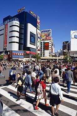 People on road crossing in Shibuya-Ku area, Tokyo, Japan, Asia