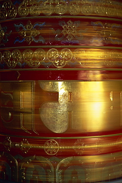 Large gold and red spinning Buddhist prayer wheels at Bodhnath Stupa in Kathmandu, Nepal, Asia
