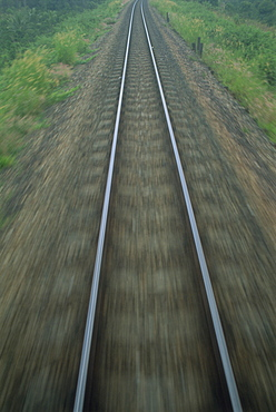 Railway tracks seen from a train at speed