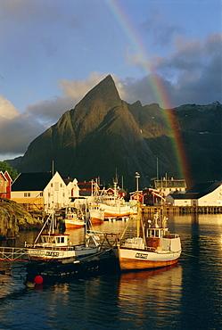 Rainbow over the colourful fishing village of Hamnoy, Moskenesoya, Lofoten Islands, Nordland, Norway, Scandinavia, Europe