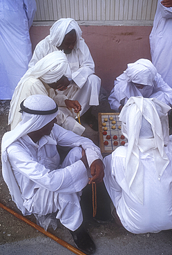 Playing a board game, Muharraq, Bahrain *** Local Caption ***