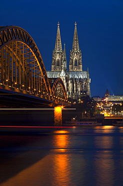 Cologne cathedral, UNESCO World Heritage Site, and Hohenzollern bridge at dusk, Cologne, Germany, Europe