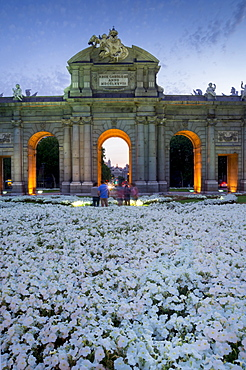 Puerto de Alcala at dusk and white flowerbed, Madrid, Spain, Europe