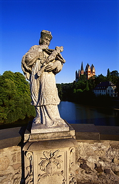 Statue on the Old Lahn-Bridge and a Cathedral in Limburg,  Germany
