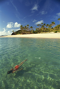 Girl swimming underwater, Yasawa Island, Fiji, Pacific Islands, Pacific