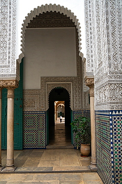 Man wanders down a long corridor decorated in Moorish style, Mahkama du Pacha, former Law Courts, Casablanca, Morocco, North Africa, Africa