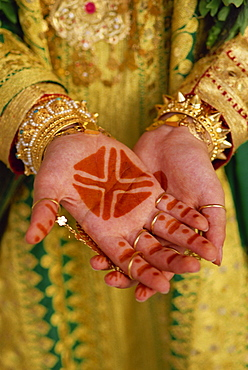 Traditional henna tattoos on hands of a young girl, Bahrain, Middle East