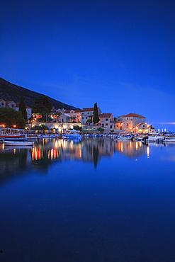 Bol Harbour lit up at dusk, Bol, Brac Island, Dalmatian Coast, Croatia, Europe
