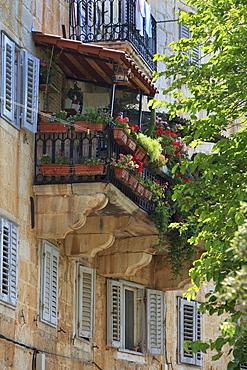 Flower covered balcony on old stone house, Bol, Brac Island, Dalmatian Coast, Croatia, Europe