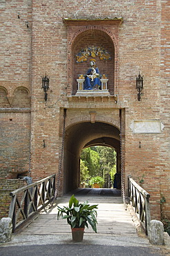 Entrance gatehouse at the Benedictine Monastery famous for frescoes in cloisters depicting the life of St. Benedict, Monte Oliveto Maggiore, Tuscany, Italy, Europe