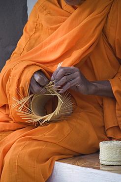 Monk making basket, Laos, Indochina, Southeast Asia, Asia