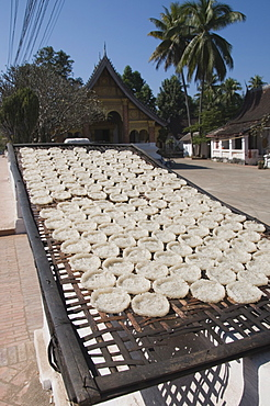 Drying rice cakes for monks, Luang Prabang, Laos, Indochina, Southeast Asia, Asia