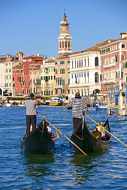 Gondolas and gondoliers, palaces facades and church steeple, Grand Canal, Venice, UNESCO World Heritage Site, Veneto, Italy, Europe