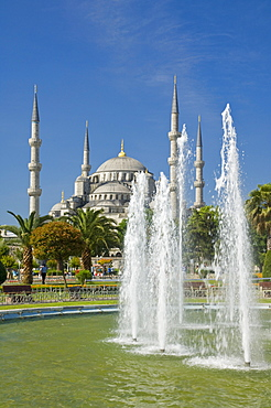 The Blue Mosque (Sultan Ahmet Camii) with domes and minarets, fountains and gardens in foreground, Sultanahmet, central Istanbul, Turkey, Europe