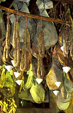 France, Corsica Island, Corse-Du-Sud, Porto-Vecchio, L'orriu Shop Of Corsican Fine Products Danielle Andreani Owner, Drying Hams Suspended From The Ceiling