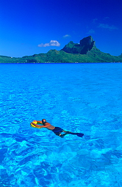 French Polynesia, Leeward Islands, Borabora, Landscape Of The Lagoon With A Swimmer In Foreground