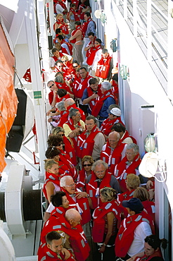 Passengers wearing lifejackets on cruise ship, Mediterranean, Europe