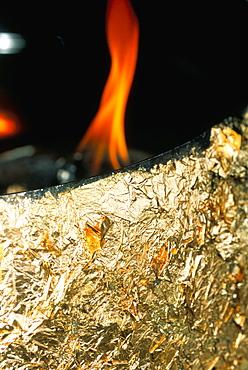 Flame at the Erawan shrine, Bangkok, Thailand, Southeast Asia, Asia