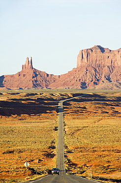 A long straight road leads into Monument Valley Navajo Tribal Park, Arizona, United States of America, North America