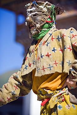 Dancers in costume at Tsechu (festival), Gangtey Gompa (Monastery), Phobjikha Valley, Bhutan, Asia