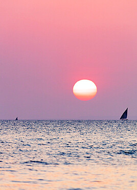 Dhow sailing boat on Indian Ocean at sunset, Stone Town, Zanzibar Island, Tanzania, East Africa, Africa