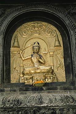 Close-up of gold relief carving of Manjushri, Bodhgaya (Bodh Gaya), Bihar state, India, Asia