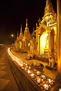 Oil lamps, Shwedagon Pagoda, Yangon (Rangoon), Myanmar (Burma), Asia