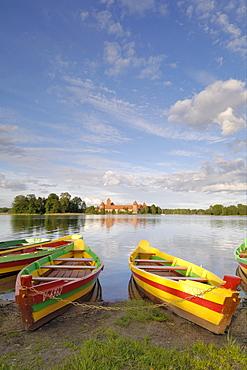 Colourful rowing boats and Trakai Castle, Trakai, near Vilnius, Lithuania, Baltic States, europe