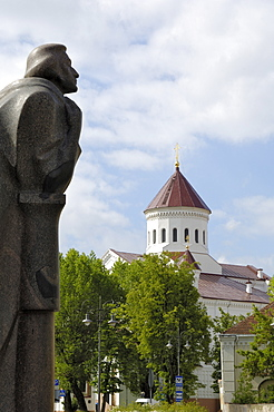 Statue of Adam Mickiewicz with Church of the Holy Mother of God in the background, Vilnius, Lithuania, Baltic States, Europe